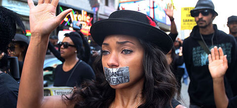 People march on Hollywood Boulevard in protest of the decision in New York not to indict a police officer involved in the chokehold death of Eric Garner on December 6, 2014, in  Los Angeles.