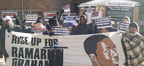 """Protestors hold banner that says, """"Rise up for Ramarley Graham"""""""