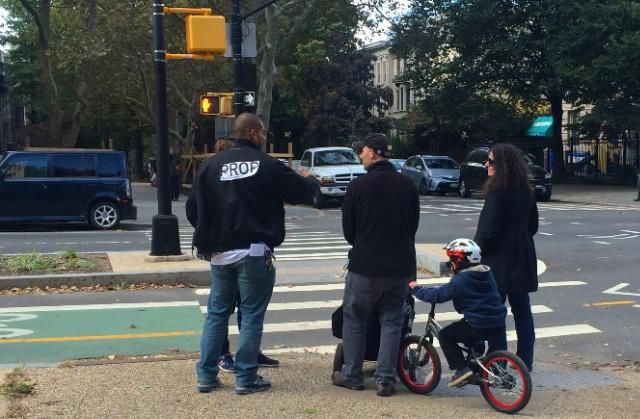 Josmar Trujillo issues a mock summons to a family in Park Slope