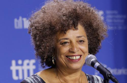 Angela Davis in blue patterned shirt against blue background