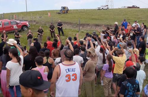 Colorlines screen shot of standoff between protestors and police from Urban Native Era video, taken on August 19, 2016.