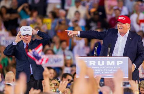 Jeff Sessions and Donald Trump on stage at rally.