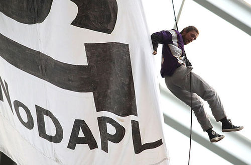 A protestor of the Dakota Access Pipeline hangs by a harness from the rafters during the second quarter of the Minnesota Vikings and Chicago Bears game on January 1, 2017, at U.S. Bank Stadium in Minneapolis, Minnesota.