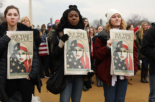 People watch on the National Mall the inauguration of President Donald Trump on January 20, 2017, in Washington, D.C. Washington and the entire world have watched the transfer of the United States presidency from Barack Obama to Trump, the 45th president.