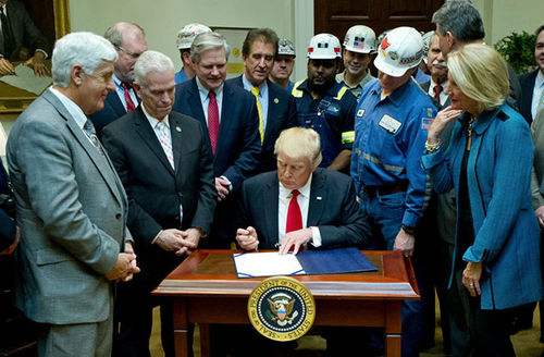 Trump signs bill to roll back last-minute Obama coal mining regulation