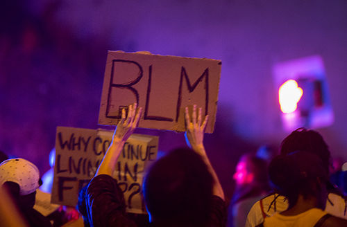 A protester holds a Black Lives Matter placard during march in reaction to the fatal police shooting of unarmed black man, Alfred Olango, on September 30, 2016, in El Cajon, California.