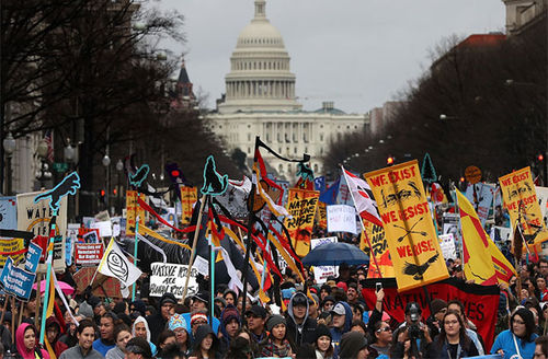 Protesters march during a demonstration against the Dakota Access Pipeline on March 10, 2017, in Washington, D.C.