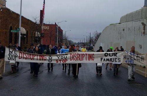 Activists—undocumented immigrants and their allies—hold their banner in solidarity with immigrants who are facing increased ICE detentions.