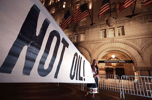 Native Americans and their supporters rally in front of the Trump International Hotel April 27, 2017, in Washington, D.C., to protest the Dakota Access Pipeline, the Keystone XL Pipeline and others they say damage the environment.
