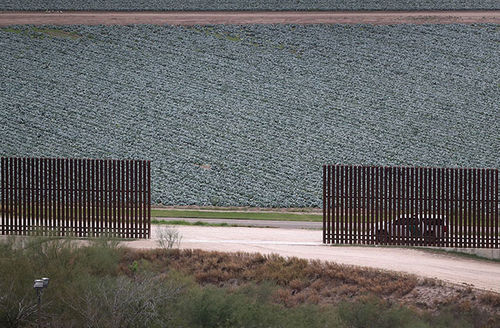 ]A U.S. Border Patrol vehicle sits waiting for undocumented immigrants at a fence opening near the U.S.-Mexico border on January 5, 2017, near McAllen, Texas.