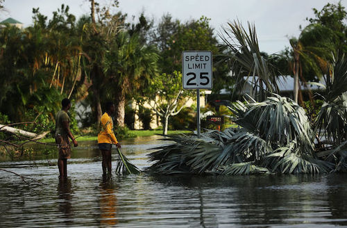 People walk through flooded streets the morning after Hurricane Irma swept through the area on September 11, 2017 in Naples, Florida.