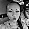Black and white selfie of Black woman with braids and her young son