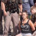 Colorlines screen shot of an arrest taking place at the protest, courtesy of Urban Native Era, taken on August 12, 2016.