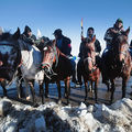 Native American riders listen at an interfaith ceremony at Oceti Sakowin Camp on the edge of the Standing Rock Sioux Reservation on December 4, 2016, outside Cannon Ball, North Dakota.