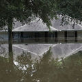 A flooded home is seen on August 15, 2016, in Baton Rouge, Louisiana. Record-breaking rains pelted Louisiana that weekend leaving the city with historic levels of flooding that caused 13 deaths and damaged thousands of homes.