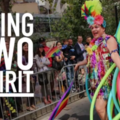 "Person in colorful outfit, text on screen reads: ""Being Two Spirit"""