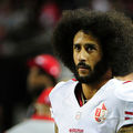 Colin Kaepernick of the San Francisco 49ers looks on from the sidelines during a game against the Atlanta Falcons on December 18, 2016, in Atlanta, Georgia. He announced his December donations for his $1 million pledge Friday, January 6.