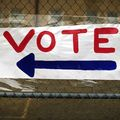 """Red, white and blue handmade sign says, """"Vote."""""""