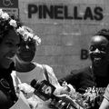 Two Black women with floral wreaths around their heads who were bailed out of  Pinellas County Jail in Clearwater, Florida, by Dream Defenders on May 11, 2017, talk to a reporter about National Bail Out day.