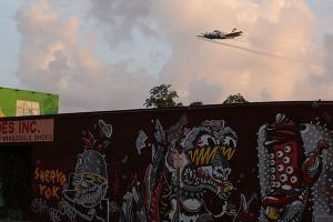 A plane sprays pesticide over the Wynwood neighborhood of Miami, Florida, on August 6, 2016, in hope of controlling and reducing the number of mosquitos. A Texan contracted the virus after spending time in the city.