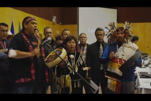 Indigenous chiefs sing and hit their drums before signing onto the Treaty Alliance Against Tar Sands Expansion on September 22, 2016, in Vancouver, Canada.