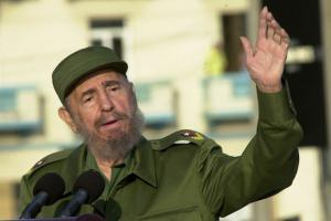 In his signature green military fatigues Fidel Castro makes a speech at a Havana podium in 2004.