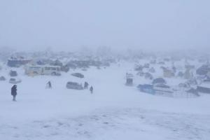 Currently under blizzard warning, snow covers the Oceti Sakowin Camp on November 29, which is under evacuation orders by the North Dakota governor.