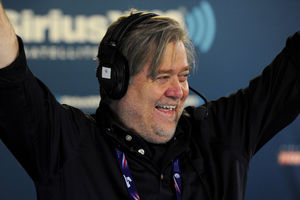 """Stephen K. Bannon smiles and raises his hands during an episode of """"Breitbart News Daily"""" on SiriusXM radio"""