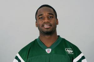 Black man in green and white New York Jets jersey