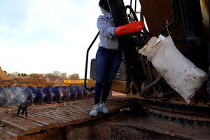 A water protector who has chosen to remain unnamed locks herself to a piece of construction equipment on January 12, 2017. She was not arrested.