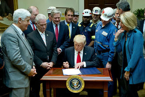 President Donald Trump signs H.J. Res. 38, disapproving the Stream Protection Rule on February 16, 2017, in Washington, D.C. He is surrounded by coal miners and opponents of the original rule.