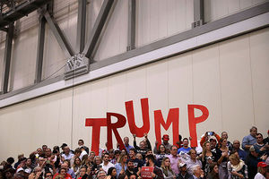 Supporters wait for the arrival of Republican presidential nominee Donald Trump and vice presidential nominee Governor Mike Pence during their final campaign rally on Election Day in the Devos Place November 8, 2016, in Grand Rapids, Michigan.