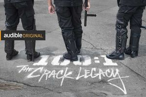 People in tactical gear stand behind spray painted words on ground that read: 100:1 The Crack Legacy