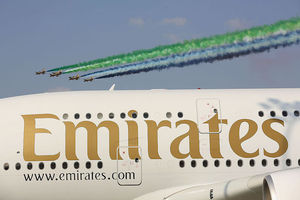 """Plane with """"Emirates"""" written on the side"""