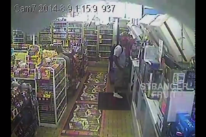 Michael Brown stands at a counter in a convenience store