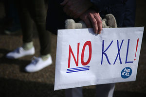 An activist holds a sign during a protest in front of the White House against the Keystone XL pipeline January 13, 2015, in Washington, D.C. They won that fight, but it's returned under a new administration.