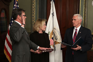 Rick Perry (L) is sworn in by Vice President Mike Pence (R), as Perry's wife Anita looks on during the March 2, 2017, ceremony in Washington, D.C.