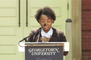 Black woman speaks into microphone