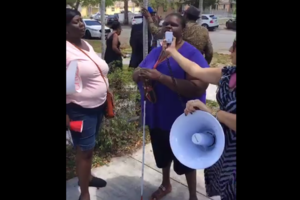Woman speaks through bullhorn