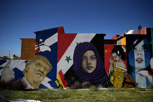 A colorful mural on the side of a home includes a sneering portrait of President Donald Trump