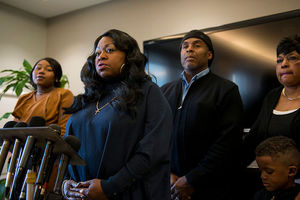 Valerie Castile and familiy. Black family at a microphone stand.