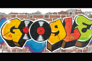 Red and blue and yellow and green graffiti with red and black vinyl records on red brick on white background
