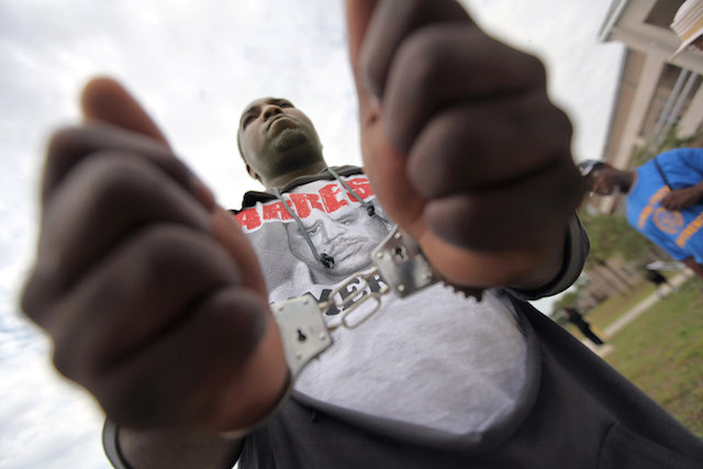 Protester Ken Gates' hands are cuffed while marching to an NAACP rally in front of the Sanford Police Department