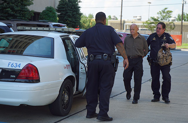 John Clark is arrested after standing his ground outside the Bureau of Ocean Energy Management offices in Jefferson Parish, Louisiana.