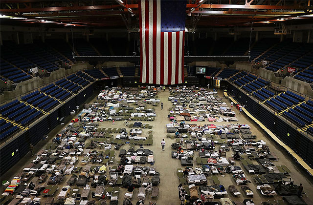 Evacuees take advantage of the shelter setup in the Baton Rouge River Center shelter. Crystal Williams, founder of North Baton Rouge Matters, says the shelter is heavily policed, even kicking some people out for suspicions of stealing.