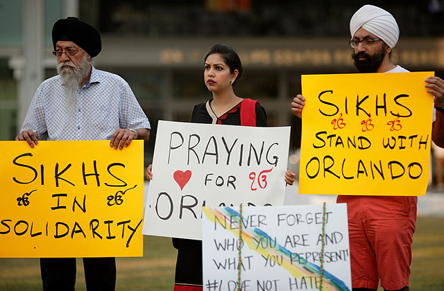 A group of Sikhs stand near a memorial site for the victims of the Pulse Nightclub shooting, June 15, 2016, in Orlando, Florida. Local community members will recognize the victims again during a memorial for the Sikh massacre tomorrow (Aug. 6).