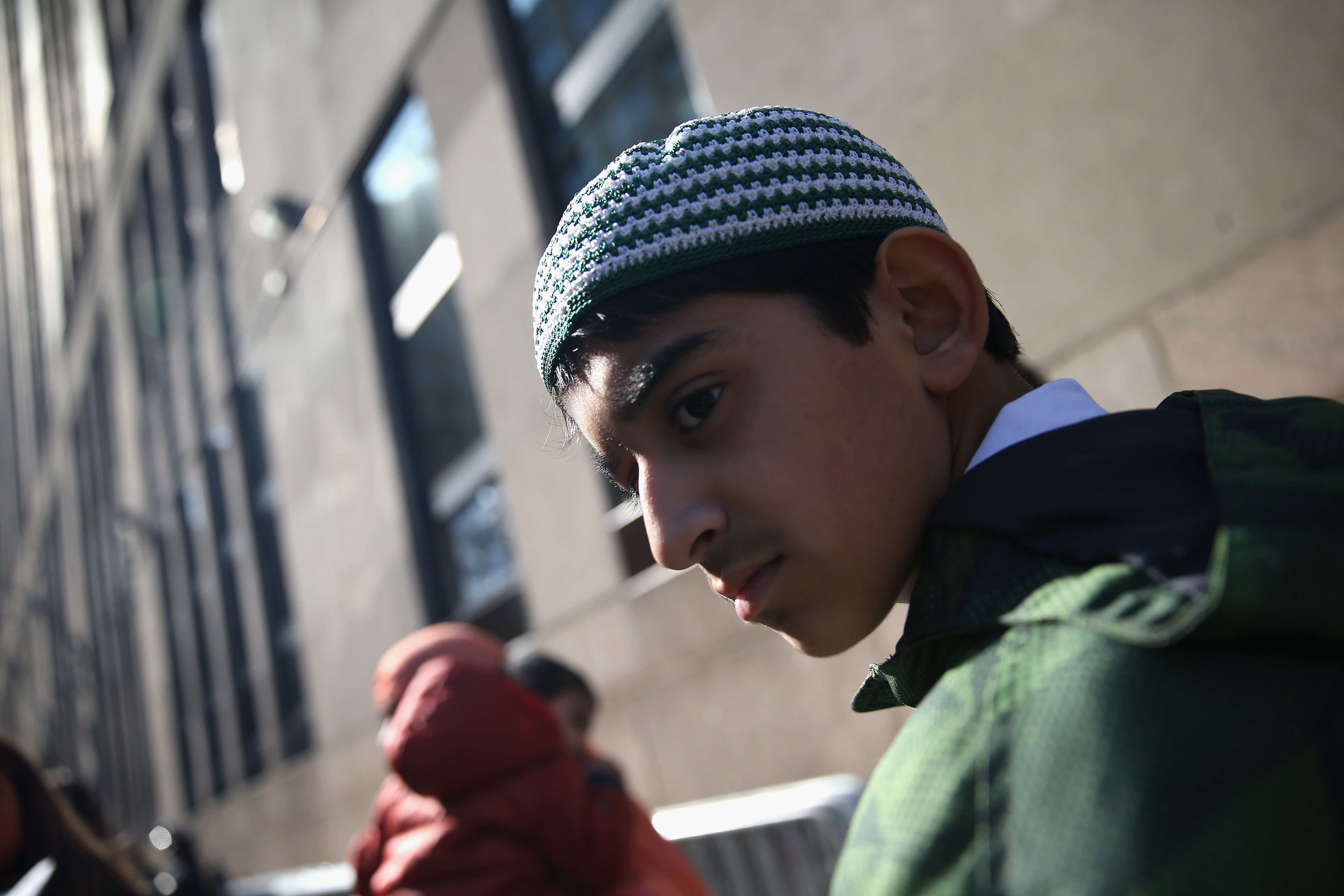Bangladeshi-American 13-year-old Mohammad Khan stands outside of ICE in NYC