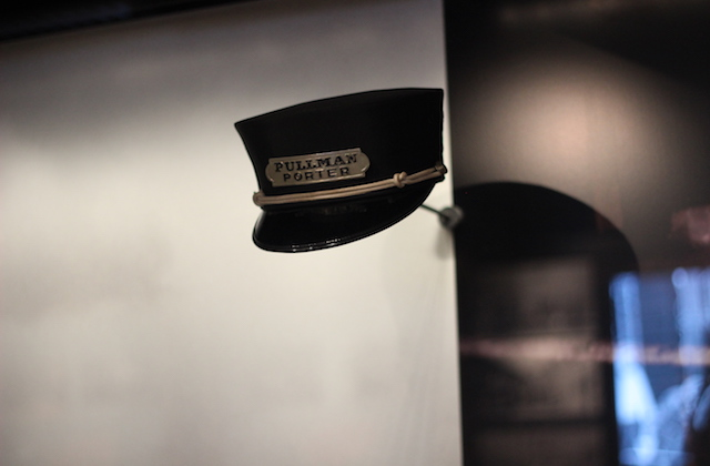 Black hat with gold plaque and black lettering