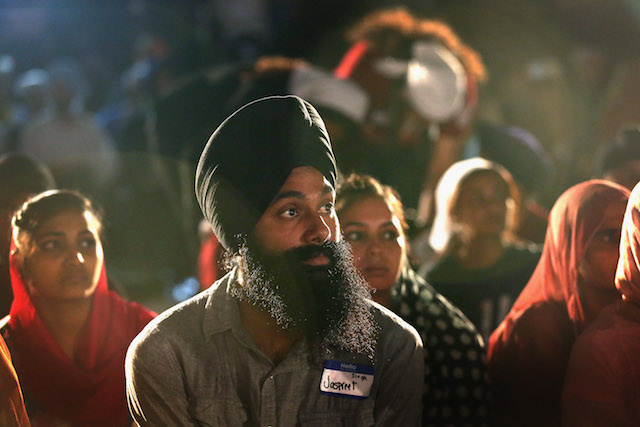 In the evening Sikh men and women attend a vigil to mark the one-year anniversary of the Oak Creek massacre