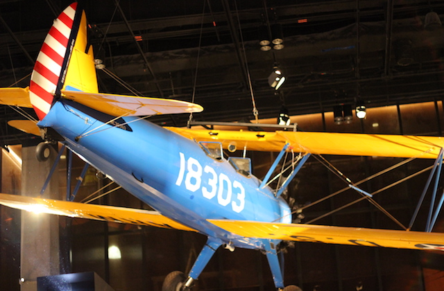 Blue airplane with yellow stripes and white number
